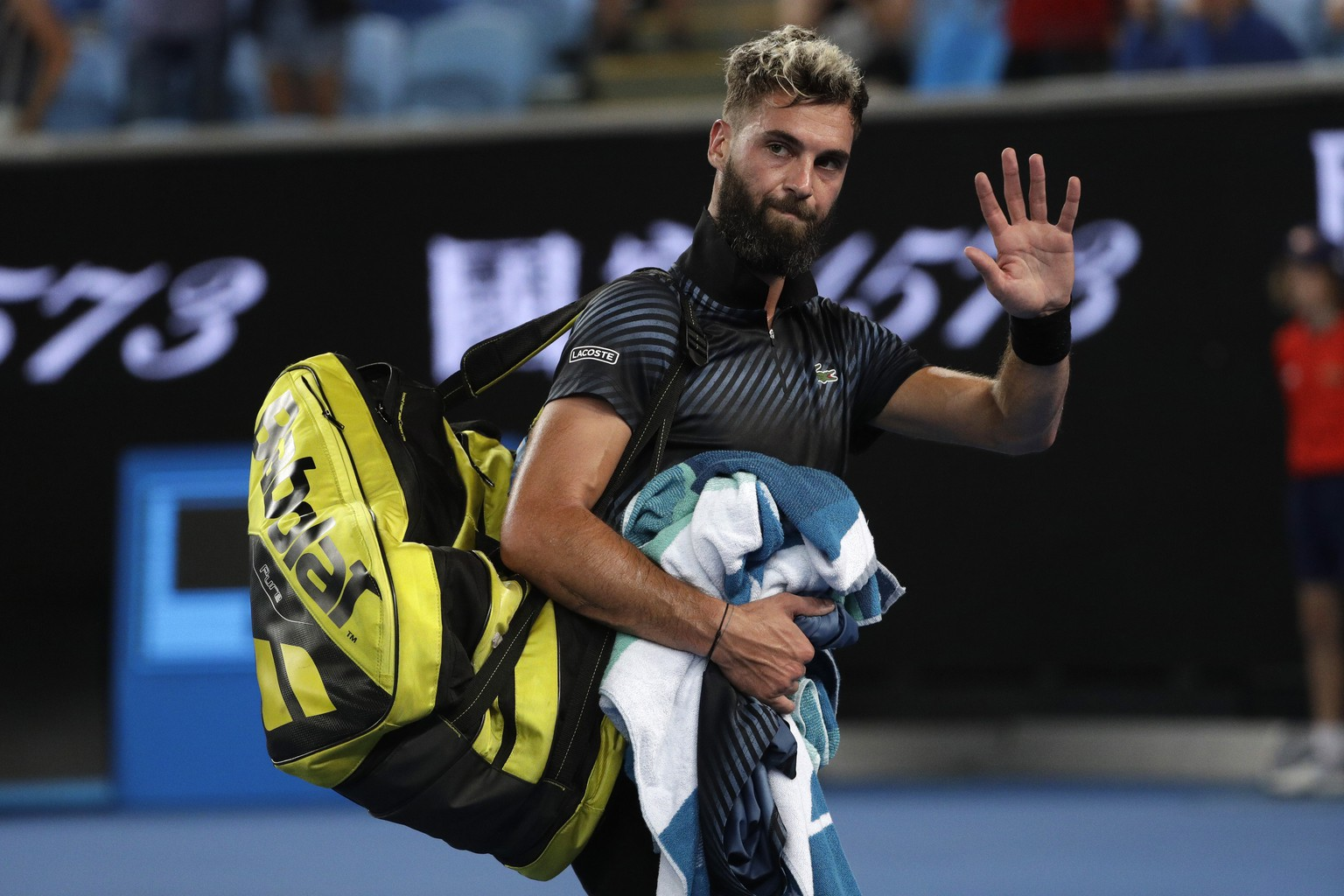 France's Benoit Paire leaves the court after losing to Austria's Dominic Thiem in their first round match at the Australian Open tennis championships in Melbourne, Australia, early Wednesday, Jan. 16, 2019. (AP Photo/Mark Schiefelbein)
