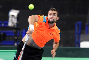 Croatia's Marin Cilic serves the ball to Poland's Jerzy Janowicz during their Davis Cup group I second round tennis match in Warsaw, Poland, Sunday, April 6, 2014. (AP Photo/Alik Keplicz)