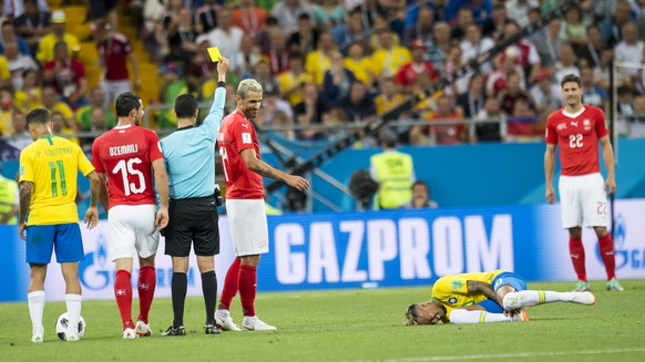 Switzerland's midfielder Valon Behrami, 3rd left, reacts next to Brazil's forward Neymar, right, during the FIFA soccer World Cup 2018 group E match between Switzerland and Brazil at the Rostov Arena, in Rostov-on-Don, Russia, Sunday, June 17, 2018. (KEYSTONE/Laurent Gillieron)