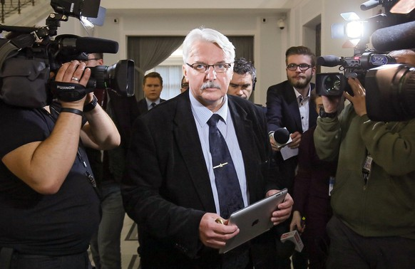 epa05019506 Law and Justice deputy and candidate for new Polish Foreign Minister Witold Waszczykowski (C) before the Law and Justice (PiS) Parliamentary Club meeting in Sejm in Warsaw, Poland, 10 November 2015. Elections winner Law and Justice (PiS) party has decided that Marek Kuchcinski is Law and Justice candidate for the Sejm Speaker (lower house). First sitting of the new Polish Parliament is scheduled for 12 November 2015.  EPA/PAWEL SUPERNAK POLAND OUT