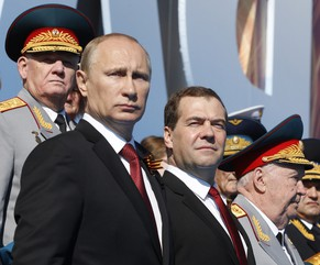 epa04197783 Russian President Vladimir Putin (front L) and Russian  Prime Minister Dmitry Medvedev (front C)  attend a military parade marking the 69th anniversary of the victory over the Nazi Germany in the WWII in the Red Square in Moscow, Russia 09 May 2014.  EPA/DMITRY ASTAKHOV/RIA NOVOSTI/ GOVERNMENT PRESS SERVICE POOL MANDATORY CREDIT