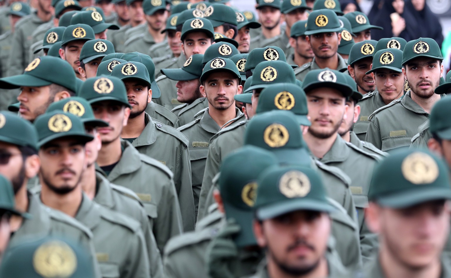 epa07367776 (FILE) - Members of Iranian revolutionary guards corps (IRGC) shout slogans during a ceremony marking the 40th anniversary of the 1979 Islamic revolution, at the Azadi (Freedom) square in Tehran, Iran, 11 February 2019 (Reissued 13 February 2019). According to IRGC official website (Sepahnews), a bombing that targeted a bus carrying members of Iran's Revolutionary Guard in the country's far southeast has killed at least 27 and injured 13.  EPA/ABEDIN TAHERKENAREH