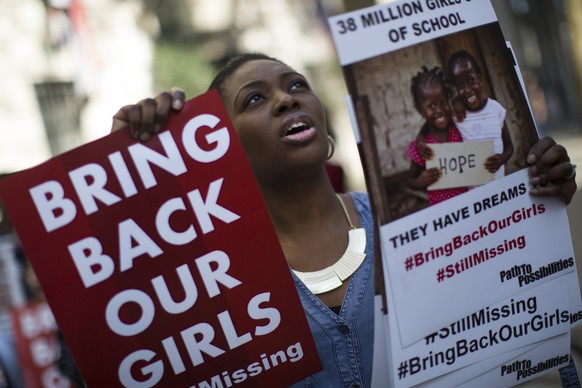 LONDON, ENGLAND - APRIL 14:  A woman holds a sign as other protesters gather outside Nigeria House to mark the one year anniversary since a group of Nigerian schoolgirls were abducted on April 14, 2015 in London, England. Two hundred and seventy-six schoolgirls were abducted from their boarding school on 14 April, 2014 in the town of Chibok in north-eastern Borno state in Nigeria. The abductions sparked protests around the world calling for the release of the girls who continue to be held by the militant group Boko Haram.  (Photo by Dan Kitwood/Getty Images)