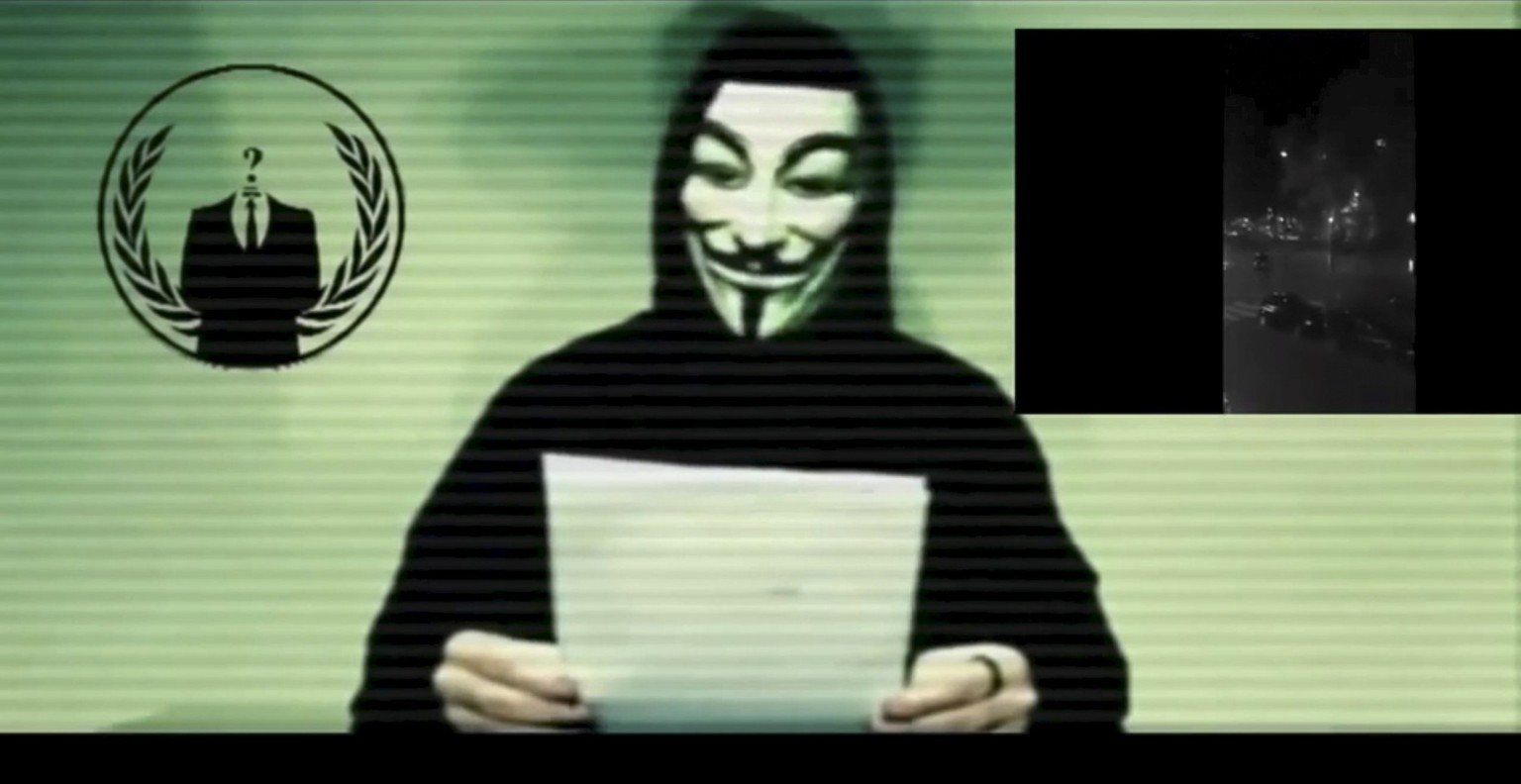 A man wearing a mask associated with Anonymous makes a statement in this still image from a video released on social media on November 16, 2015. Anonymous, the loose-knit network of activist hackers known for cyber attacks on government, corporate and religious websites, is preparing to unleash waves of cyberattacks on Islamic State following the attacks in Paris last week that killed 129 people, self-described members said in a video posted online.  REUTERS/Social Media Website via Reuters TV ATTENTION EDITORS - THIS PICTURE WAS PROVIDED BY A THIRD PARTY. REUTERS IS UNABLE TO INDEPENDENTLY VERIFY THE AUTHENTICITY, CONTENT, LOCATION OR DATE OF THIS IMAGE. FOR EDITORIAL USE ONLY. NOT FOR SALE FOR MARKETING OR ADVERTISING CAMPAIGNS. NO RESALES. NO ARCHIVE. THIS PICTURE IS DISTRIBUTED EXACTLY AS RECEIVED BY REUTERS, AS A SERVICE TO CLIENTS.
