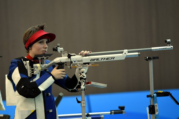 NANJING, CHINA - AUGUST 19: Sarah Hornung of Switzerland prepares to shoot during Day 3 of the 2014 Summer Youth Olympic Games of the Girls 10m Air Rifle Final Competition at the Fangshan Shooting Hall on August 19, 2014 in Nanjing, China.  (Photo by Stanley Chou/Getty Images)