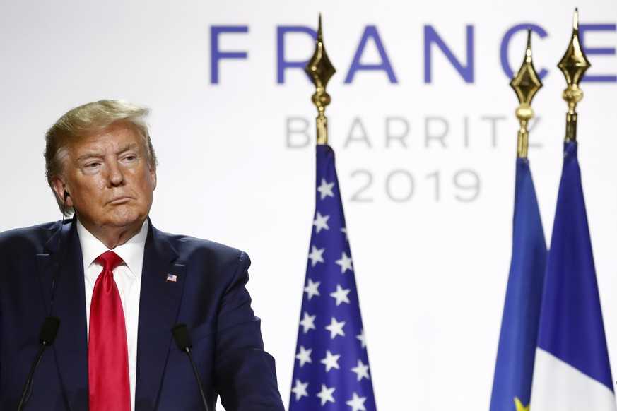 epa07795434 US President Donald J. Trump speaks during a press conference on the closing day of the G7 summit in Biarritz, France, 26 August 2019.  EPA/IAN LANGSDON