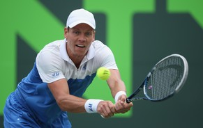 KEY BISCAYNE, FL - MARCH 27:   Tomas Berdych of the Czech Republic plays a backhand against Alexandr Dolgopolov of the Ukraine during their quarter final round match during day 11 at the Sony Open at Crandon Park Tennis Cente on March 27, 2014 in Key Biscayne, Florida.  (Photo by Clive Brunskill/Getty Images)
