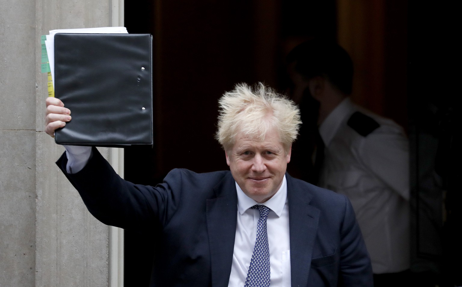 Britain's Prime Minister Boris Johnson leaves 10 Downing Street to attend the weekly Prime Ministers' Questions session, in parliament in London, Wednesday, Oct. 23, 2019. (AP Photo/Frank Augstein)