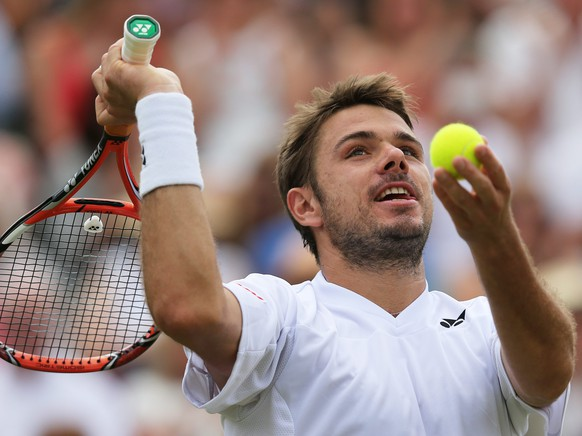 epa04293813 Stan Wawrinka of Switzerland during his fourth round match against Feliciano Lopez of Spain at the Wimbledon Championships at the All England Lawn Tennis Club, in London, Britain, 01 July 2014.  EPA/TATYANA ZENKOVICH