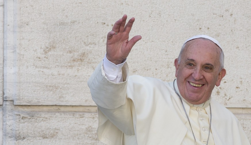 Pope Francis waves to members of the media as he leaves a morning session of a two-week synod on family issues, at the Vatican, Friday, Oct. 10, 2014. Gay rights groups are cautiously cheering a shift in tone from the Catholic Church toward homosexuals, encouraged that Pope Francis' famous