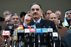 Saleh al-Mutlaq, head of the Sunni Arab National Dialog Front, center, speaks at a press conference by the Maram alliance in Baghdad, Iraq, Tuesday, Jan. 3, 2006. The Maram alliance, which includes both Sunni Arabs and secular Shiite factions, claimed that the results of the country's parliamentary elections were tainted with fraud. (KEYSTONE/AP Photo/Xinhua, Ghassan Awad)