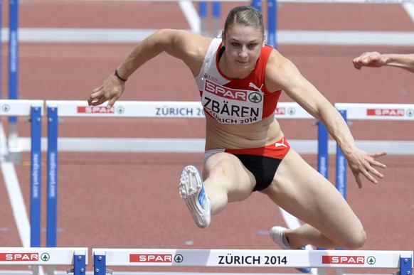Noemi Zbaeren from Switzerland competes in the women's 100m hurdles round 1race, at the first day of the European Athletics Championships in the Letzigrund Stadium in Zurich, Switzerland, Tuesday, August 12, 2014. (KEYSTONE/Walter Bieri)
