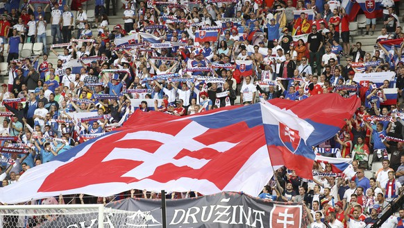 Slovakian supporters display a giant flag prior to the Euro 2016 Group B soccer match between Wales and Slovakia, at the Nouveau stadium in Bordeaux, France, Saturday, June 11, 2016. (AP Photo/Andrew Medichini)
