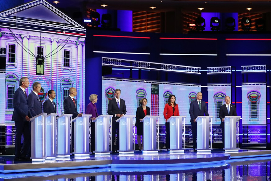 Democratic presidential candidates from left, New York City Mayor Bill de Blasio, Rep. Tim Ryan, D-Ohio, former Housing and Urban Development Secretary Julian Castro, Sen. Cory Booker, D-N.J., Sen. Elizabeth Warren, D-Mass., former Texas Rep. Beto O'Rourke, Sen. Amy Klobuchar, D-Minn., Rep. Tulsi Gabbard, D-Hawaii, Washington Gov. Jay Inslee, and former Maryland Rep. John Delaney participate in a Democratic primary debate hosted by NBC News at the Adrienne Arsht Center for the Performing Arts, Wednesday, June 26, 2019, in Miami.  (AP Photo/Wilfredo Lee)