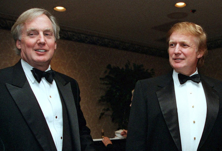 FILE - In this Nov. 3, 1999, file photo, Robert Trump, left, joins then real estate developer and presidential hopeful Donald Trump at an event in New York. President Donald Trump's younger brother, Robert Trump, a businessman known for an even keel that seemed almost incompatible with the family name, died Saturday night, Aug. 15, 2020, after being hospitalized in New York, the president said in a statement. He was 71. The president visited his brother at a New York City hospital Friday after White House officials said Robert Trump had become seriously ill. (AP Photo/Diane Bonadreff, File) Donald Trump,Robert Trump