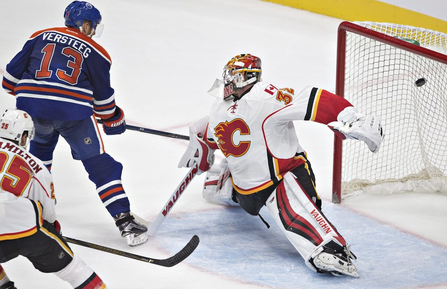 Calgary Flames goalie Jon Gillies (32) is scored on by Edmonton Oilers' Kris Versteeg (13) during the third period of an NHL hockey preseason game Monday, Sept. 26, 2016, in Edmonton, Alberta. (Jason Franson/The Canadian Press via AP)