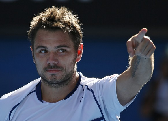Stan Wawrinka of Switzerland celebrates after defeating Kei Nishikori of Japan in their quarterfinal match at the Australian Open tennis championship in Melbourne, Australia, Wednesday, Jan. 28, 2015. (AP Photo/Vincent Thian)