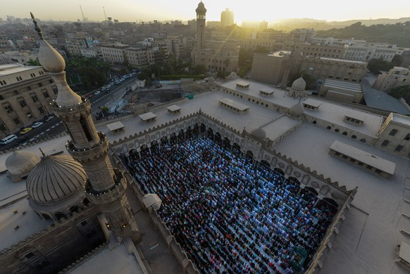 Worshippers take part in Eid al-Adha prayers at Al-Azhar mosque in Cairo, Egypt, Thursday, Sept. 24, 2015. Muslims around the world celebrate Eid al-Adha, which commemorates the willingness of the prophet Ibrahim, or Abraham as he is known in the Bible, to sacrifice his son in accordance with God's will, though in the end God provides him a sheep to sacrifice instead. (AP Photo)