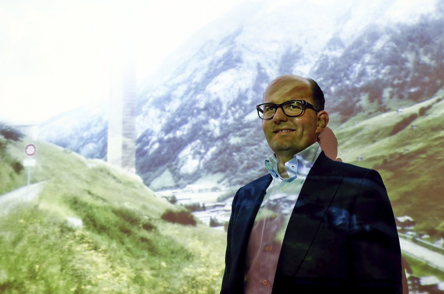 Remo Stoffel, managing director of Swiss Priora Holding AG poses in front of a picture of the planned '7132 hotel' after a news conference in the town of Kloten near Zurich March 25, 2015. Stoffel presented plans to built the '7132 hotel', a 381 metres (1,250 ft) high tower in the eastern Swiss mountain resort of Vals. the building would be the highest in Europe and the highest hotel in the world.   REUTERS/Arnd Wiegmann