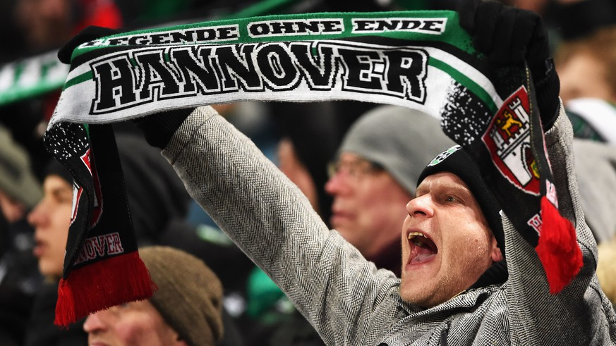 HANOVER, GERMANY - MARCH 01:  Fans of Hannover show their support during the Bundesliga match between Hannover 96 and VfL Wolfsburg at HDI-Arena on March 1, 2016 in Hanover, Germany.  (Photo by Stuart Franklin/Bongarts/Getty Images)