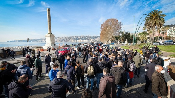 epa08895414 A view of the waterfront and nearby via Chiatamone area blocked by restaurateurs protesting against the decision of the Campania Governor Vincenzo De Luca to keep the Campania Region in the orange zone instead of the yellow one as the Ministry of Health had foreseen from today and until 23 December, in Naples, southern Italy, 20 December 2020. The move is a hard blow for restaurateurs, who have been economically affected by the pandemic and by the measures to contain it. Italy is fighting against a second wave of the coronavirus disease (COVID-19) pandemic.  EPA/CESARE ABBATE