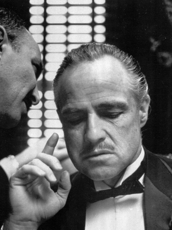 By tradition, the Godfather cannot refuse a request on his daughter's wedding day, and Bonasera, portrayed by Frank Puglia, aksa Don Corleone, portrayed by Marlon Brando, at right, for a favor in this scene from the 1972 movie