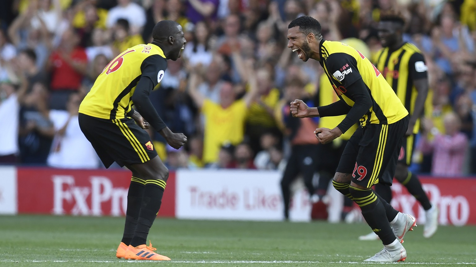 epa06992994 Watford's Abdoulaye Doucoure (L) and Etienne Capoue (R) celebrate their win after  the English Premier League soccer match between Watford and Tottenham at Vicarage Road,  Watford, London, Britain, 02 September 2018.  EPA/WILL OLIVER EDITORIAL USE ONLY. No use with unauthorized audio, video, data, fixture lists, club/league logos or 'live' services. Online in-match use limited to 120 images, no video emulation. No use in betting, games or single club/league/player publications.