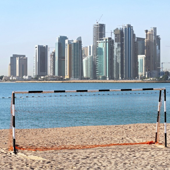 epa07655128 (FILE) - A football goal at a beach in front of the skyline of Doha, Qatar, 21 April 2015 (re-issued 18 June 2019). Former UEFA president Michel Platini has been arrested as part of an investigation in the Qatar 2022 World Cup bid, media reports claimed on 18 June 2019. Platini is believed to have been taken to the office of the Anti-Corruption Office of the Judicial Police (OCLCIFF) in Nanterre, near Paris, France.  EPA/KARL-JOSEF HILDENBRAND  GERMANY OUT *** Local Caption *** 51900240