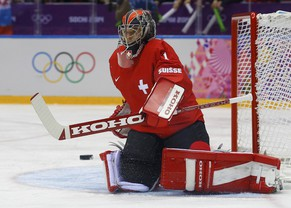 Switzerland's goalie Jonas Hiller makes a save against Latvia during the first period of their men's qualification round ice hockey game at the 2014 Sochi Winter Olympic Games, February 18, 2014.          REUTERS/Brian Snyder (RUSSIA  - Tags: SPORT ICE HOCKEY OLYMPICS)