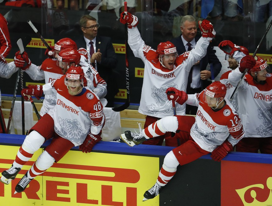 Players of Denmark celebrate after winning the Ice Hockey World Championships group B match between Finland and Denmark at the Jyske Bank Boxen arena in Herning, Denmark, Wednesday, May 9, 2018. (AP Photo/Petr David Josek)
