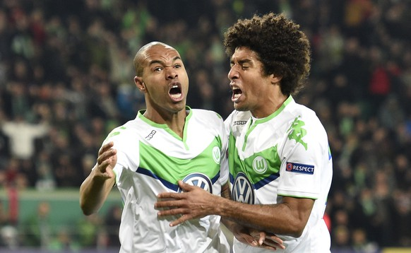 Football Soccer - VfL Wolfsburg v Manchester United - UEFA Champions League Group Stage - Group B - Volkswagen-Arena, Wolfsburg, Germany - 8/12/15 Naldo celebrates with Dante after scoring the first goal for Wolfsburg Reuters / Fabian Bimmer Livepic EDITORIAL USE ONLY.