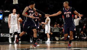 epa04729295 The Hawks' Kent Bazemore (2-L) and Al Horford (R) celebrate a run of points as the Nets' Brook Lopez (L) looks on during the second half of game six of the NBA playoff match up between the Atlanta Hawks and the Brooklyn Nets at the Barclays Center in Brooklyn, New York, USA, 01 May 2015. The Hawks beat the Nets and advance to the next round of the playoffs.  EPA/JUSTIN LANE Corbis Out