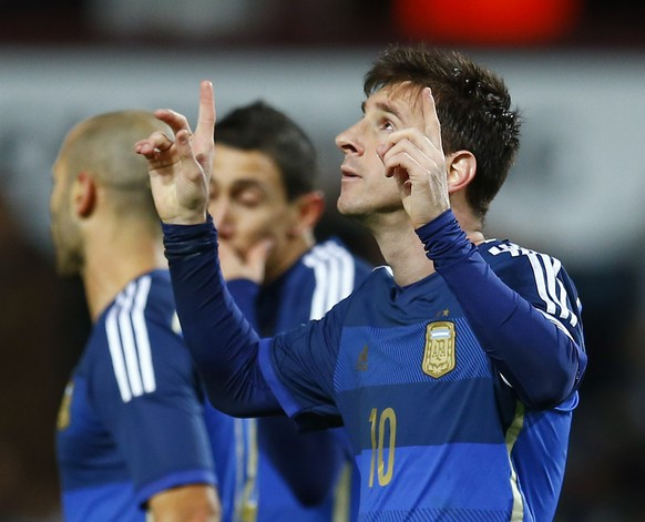 Argentina's Lionel Messi celebrates his goal from a penalty against Croatia during their international friendly soccer match at Upton Park in London November 12, 2014. REUTERS/Eddie Keogh (BRITAIN - Tags: SPORT SOCCER)
