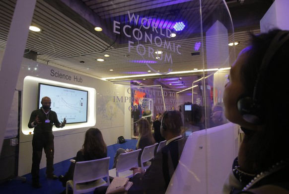 Participants of the WEF follow a presentation in the so called Science Hub on the third day of the annual meeting of the World Economic Forum in Davos, Switzerland, Thursday, Jan. 19, 2017. (AP Photo/Michel Euler)