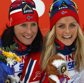 Norway's Therese Johaug, center, celebrates her victory with runner up Norway's Marit Bjoergen, left and third palced Sweden's Charlotte Kalla, at the women's 30 kms mass start event at the Nordic Skiing World Championships in Falun, Sweden, Saturday, Feb. 28, 2015. (AP Photo/Matthias Schrader)