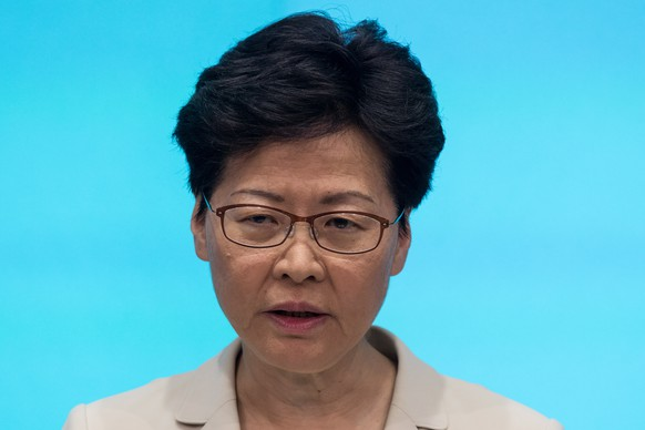 epa07655168 Hong Kong Chief Executive Carrie Lam speaks during a press conference at the Central Government Complex in Hong Kong, China, 18 June 2019. Lam issued her second apology, this time in person, for her mishandling of a controversial extradition bill, which drew an estimated two million people into the streets of Hong Kong in protest. However, Lam refused to withdraw the bill altogether.  EPA/ROMAN PILIPEY