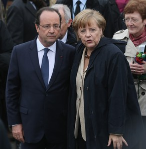 SASSNITZ, GERMANY - MAY 09:  German Chancellor Angela Merkel and French President Francois Hollande arrive to board a boat to tour the nearby chalk cliffs on Ruegen Island on May 9, 2014 in Sassnitz, Germany. Merkel and Hollande are meeting for two days on the Baltic coast.  (Photo by Sean Gallup/Getty Images)