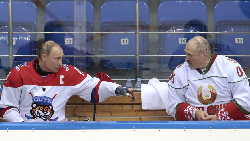 FILE In this file photo taken on Friday, Feb. 15, 2019, Russian President Vladimir Putin, left, and Belarusian President Alexander Lukashenko speak during an ice hockey game at Shayba Arena in the Black sea resort of Sochi, Russia. Responding to a question at a news conference on Friday, March 1, 2019, President Alexander Lukashenko dismissed the possibility that Russia could incorporate his nation as the two former Soviet republics discuss how to integrate their economies more, including a possible joint currency. (Sergei Chirikov/Pool Photo via AP, File)