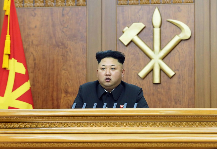 North Korean leader Kim Jong Un delivers a New Year's address in this January 1, 2015 photo released by North Korea's Korean Central News Agency (KCNA) in Pyongyang. REUTERS/KCNA (NORTH KOREA - Tags: POLITICS TPX IMAGES OF THE DAY) ATTENTION EDITORS - THIS PICTURE WAS PROVIDED BY A THIRD PARTY. REUTERS IS UNABLE TO INDEPENDENTLY VERIFY THE AUTHENTICITY, CONTENT, LOCATION OR DATE OF THIS IMAGE. FOR EDITORIAL USE ONLY. NOT FOR SALE FOR MARKETING OR ADVERTISING CAMPAIGNS. THIS PICTURE IS DISTRIBUTED EXACTLY AS RECEIVED BY REUTERS, AS A SERVICE TO CLIENTS. NO THIRD PARTY SALES. NOT FOR USE BY REUTERS THIRD PARTY DISTRIBUTORS. SOUTH KOREA OUT. NO COMMERCIAL OR EDITORIAL SALES IN SOUTH KOREA