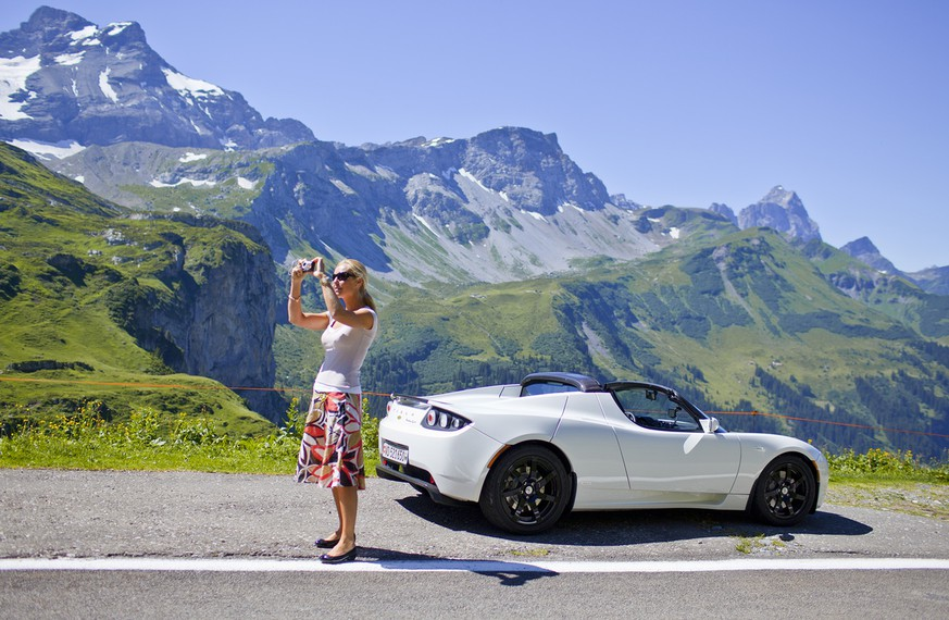 Gabriella Le Breton takes a picture on the mountain pass