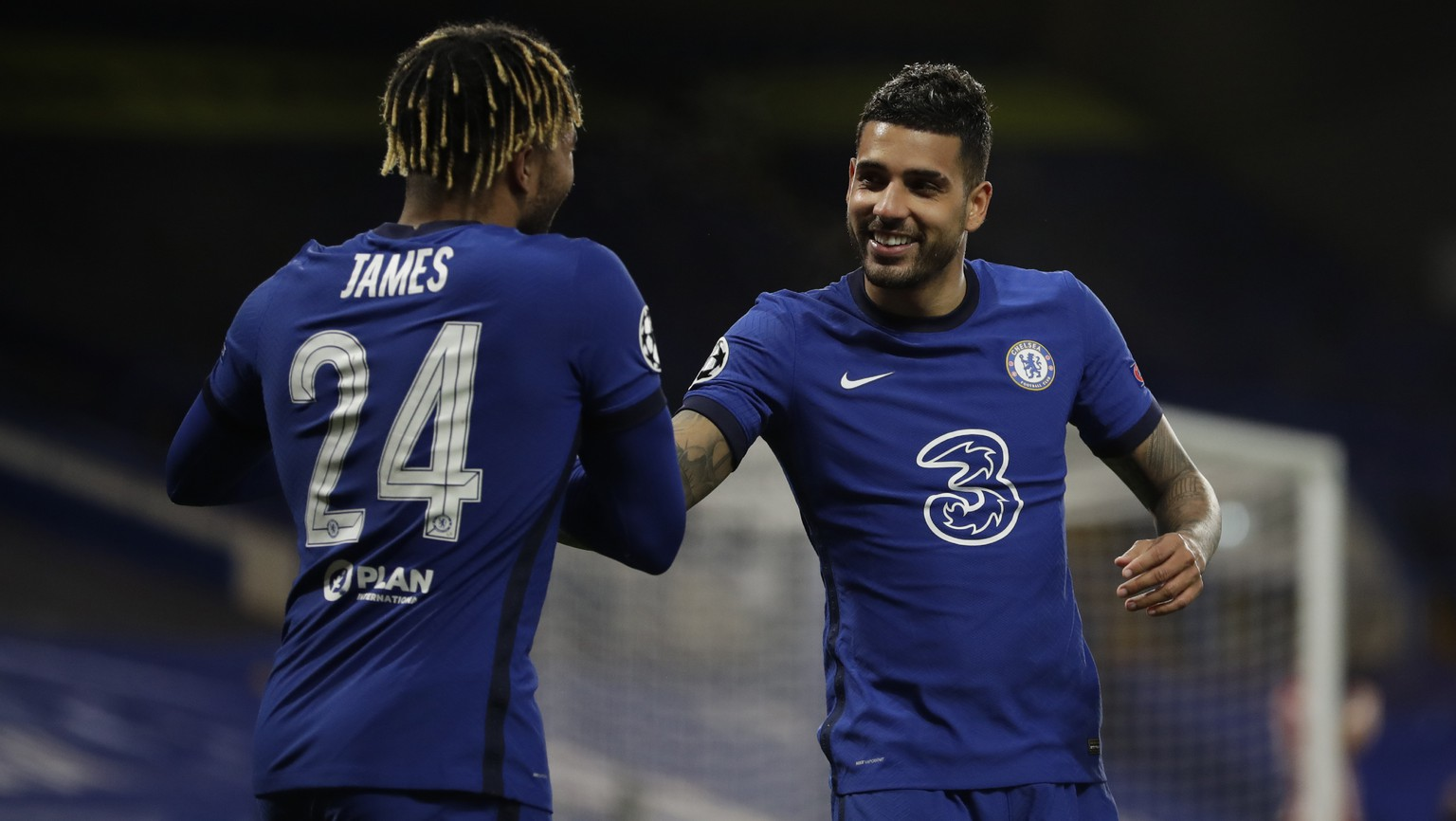 Chelsea's Emerson Palmieri, right, celebrates after scoring his side's second goal during the Champions League, round of 16, second leg soccer match between Chelsea and Atletico Madrid at the Stamford Bridge stadium, London, Wednesday, March 17, 2021. (AP Photo/Matt Dunham)