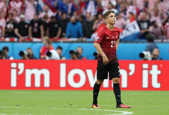 epa05359376 Emre Mor of Turkey shows his disappointment after Turkey lost 1-0 at the end the UEFA EURO 2016 group D preliminary round match between Turkey and Croatia at Parc des Princes in Paris, France, 12 June 2016.(RESTRICTIONS APPLY: For editorial news reporting purposes only. Not used for commercial or marketing purposes without prior written approval of UEFA. Images must appear as still images and must not emulate match action video footage. Photographs published in online publications (whether via the Internet or otherwise) shall have an interval of at least 20 seconds between the posting.)  EPA/ABEDIN TAHERKENAREH   EDITORIAL USE ONLY