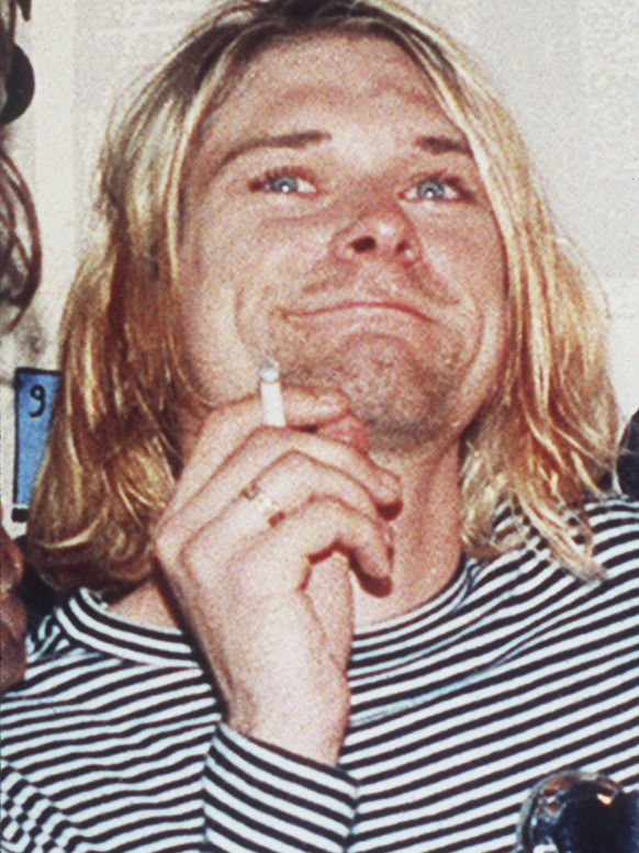 FILE - In this 1993 file photo, lead singer of Nirvana Kurt Cobain is photographed. Seattle police  in April 2014, plan to release new photographs discovered during a re-examination of the death of Nirvana's  Cobain. Cobain, who was 27 when he died.   (AP Photo/Mark J.Terrill, file)