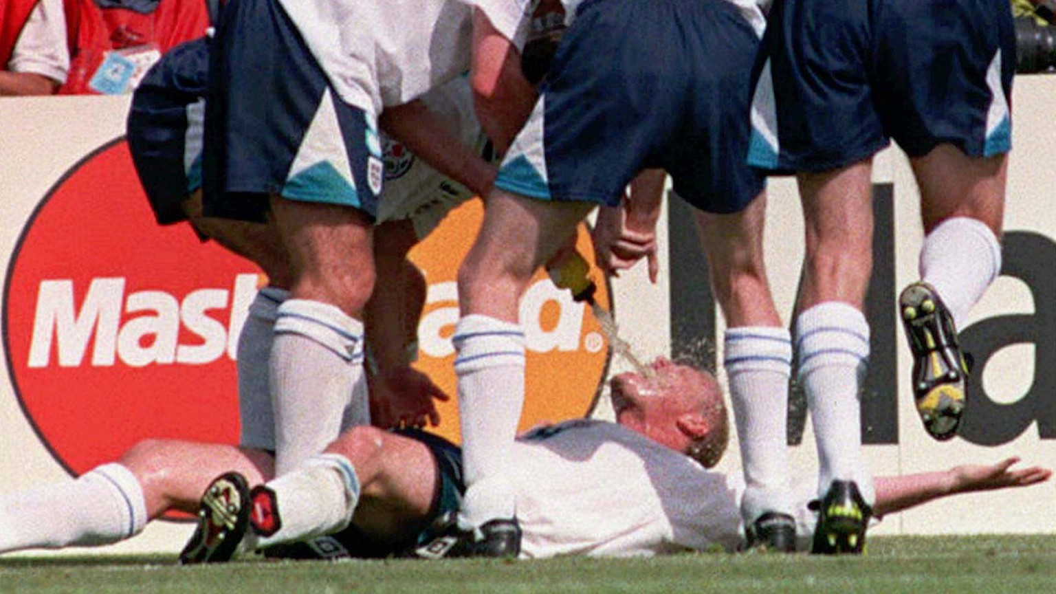 Paul Gascoigne is swamped by England teammates after scoring their second goal during their Euro 96 clash against Scotland, at Wembley, Saturday June 15 1996. England won 2-0. (AP Photo/Adam Butler)