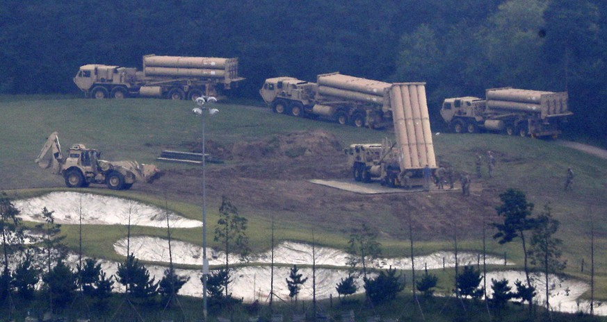 FILE - In this Sept. 7, 2017, file photo, U.S. missile defense system called Terminal High-Altitude Area Defense system, or THAAD, are seen at a golf course in Seongju, South Korea. North Korea launched an intermediate-range missile that flew over Japan in its longest-ever flight on Friday, Sept. 15, 2017, showing that leader Kim Jong Un is defiantly pushing to bolster his weapons programs despite U.S.-led international pressure. (Kim Jun-beom/Yonhap via AP, File)