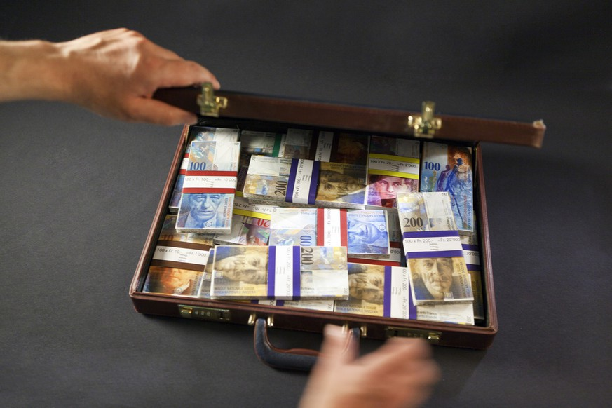 [EDITOR'S NOTE: Topical image, posed picture with fake money] A briefcase with bundles of fake banknotes of Swiss Francs, pictured on July 21, 2011. (KEYSTONE/Martin Ruetschi)