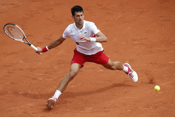 Serbia's Novak Djokovic returns a shot against Brazil's Rogerio Dutra Silva during their first round match of the French Open tennis tournament at the Roland Garros stadium in Paris, France, Monday, May 28, 2018. (AP Photo/Christophe Ena)