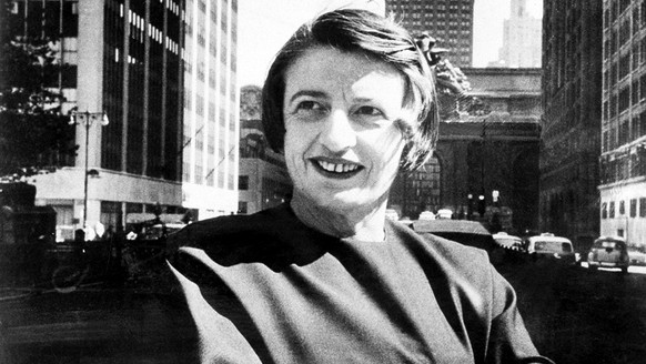 FILE - This 1962 file photo Ayn Rand, Russian-born American novelist, is photographed in New York with Grand Central Terminal in the background.  A Rand novel written, temporary shelved and later published as a play is finally being released in its original form. The New American Library, an imprint of Penguin Random House, announced Thursday, Dec. 4, 2014,  that Rand's