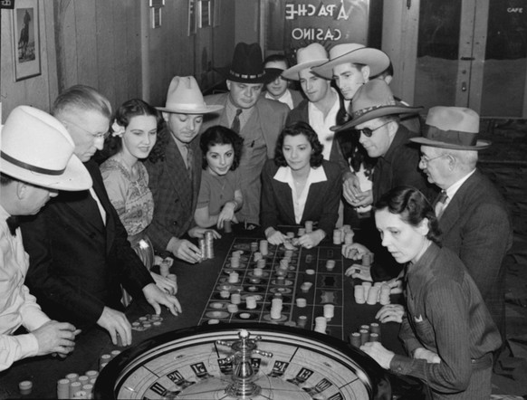 "FILE - This Jan. 29, 1939 file photo shows roulette players at the Apache Casino in Las Vegas. Divorce-seekers who throng to Las Vegas to take advantage of the six weeks residence law find that time passes quickly at the gaming tables. From 1931 to 1970, the height of the so-called ""migratory divorce"" trade, more than 325,000 marriages came to an end in the Silver State.  (AP Photo, file)"