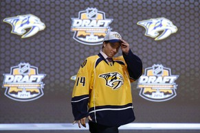 Kevin Fiala walks off the stage after being chosen 11th overall by the Nashville Predators during the first round of the NHL hockey draft, Friday, June 27, 2014, in Philadelphia. (AP Photo/Matt Slocum)